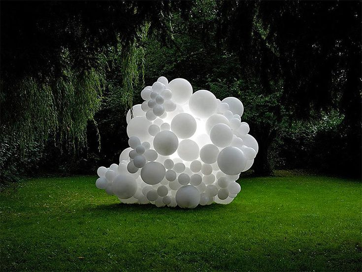 French photographer Charles Pétillon captures clusters of white balloons