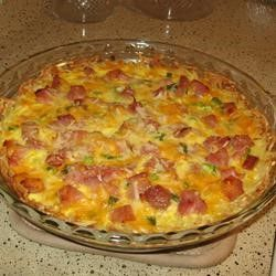 Ham and Hash Brown Quiche Recipe. I substituted bacon for the ham and added a few mushrooms. Topped it with a dollop of sour cream and green onion before serving . . . AMAZING!!!!