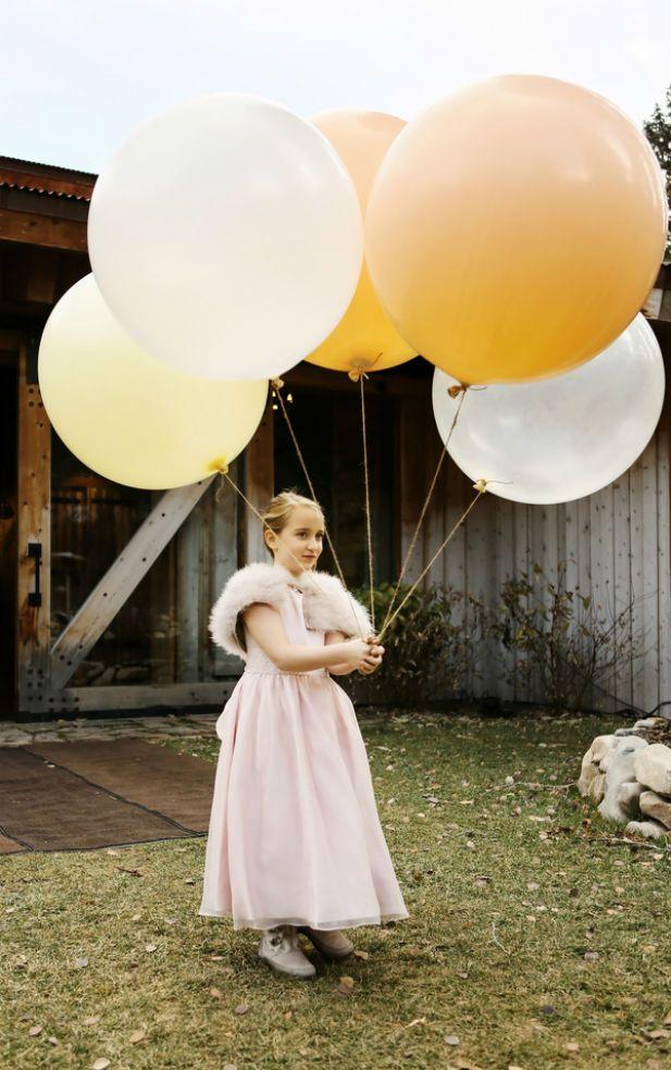 Oversized wedding balloons for the flower girl. Love this idea!