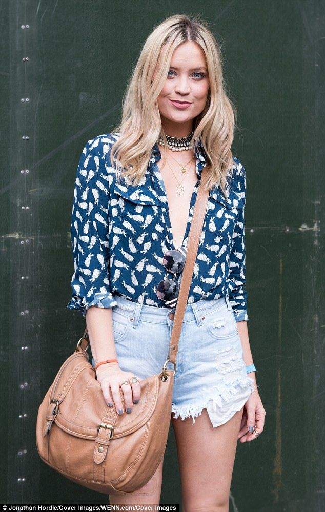Take the plunge! Laura Whitmore caught the eyes of onlookers as she went braless in a daring neckline when she attended the Mighty Hoopla Festival in Victoria Park, London on Sunday