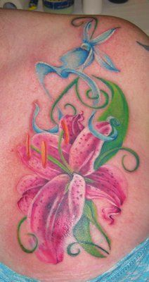 Seriously considering of getting me a lily tattooed maybe with my wedding date :)