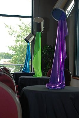 """Love this idea!  fabric """"spilling"""" from an empty paint can to look like paint pouring out--great centerpieces!"""