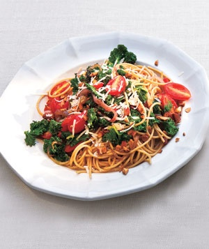 "Whole-Grain Spaghetti With Garlicky Kale and Tomatoes | Real Simple Recipes    Kale is being called ""the new beef"", ""the queen of greens"" and ""a nutritional powerhouse.""    http://www.realsimple.com/food-recipes/browse-all-recipes/whole-grain-spaghetti-with-garlicky-kale-and-tomatoes-00000000051131/index.html"
