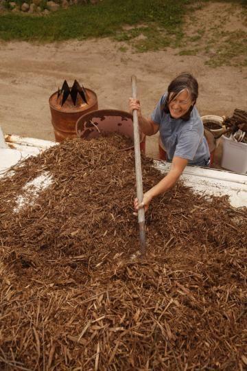 10 Steps for making biochar, well-illustrated:  Cathy Rose makes homemade biochar at her Nature's Nest Farm west of Delano, Minnesota.: