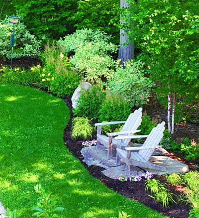 A sitting area inside the border of the flower bed for Large area landscaping ideas