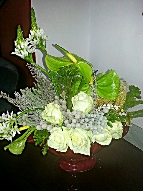 floral work at home with Banksia and roses