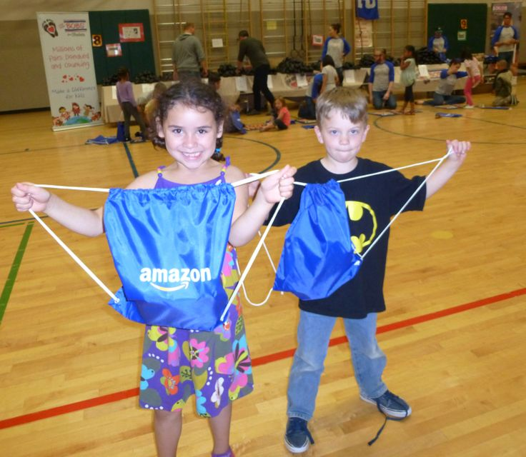 Children received @Amazon.com cinch backpacks at the Seattle, WA BOBS from SKECHERS donation event.