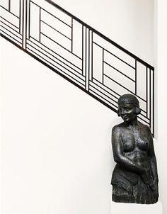 A striking iron stair rail in a Paris apartment. Interior design by the Brussels based Anne Derasse. Photo by Jörg Bräuer.
