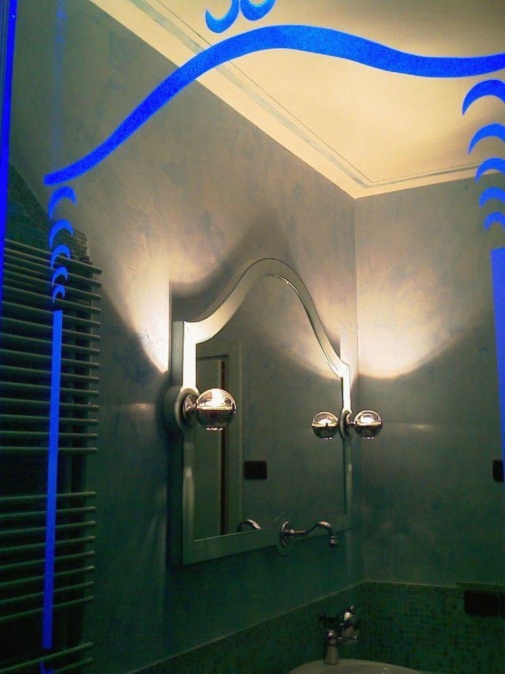 Bagno con vetri dai decori illuminabili