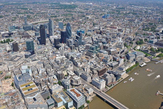 An aerial photograph of the Square Mile / City of London, with the business district's skyline dominated by Skyscrapers