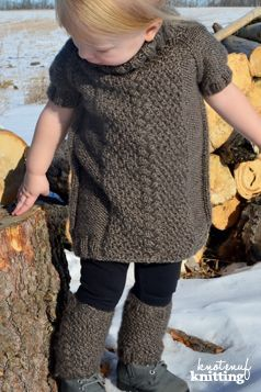 Little Olivia's Sweater Dress knitting pattern is a seamless knitting pattern for a top down raglan knit sweater dress. This knitted dress pattern features a cable stitch surrounded by the moss stitch. A great knit for little girls, this knitting project idea will keep you interested! Click through to get the knitting pattern from KnotEnufKnitting.