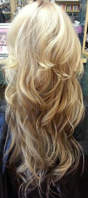 Get the look with Remy Clips clip-in extensions! You don't have to color your hair to get an ombre. Shown here is a Color#613 Light Blonde blended with natural Color #10 Honey - 24 inches long - 240 grams of hair. Long layers curled, help blend the two colors together. No commitment, no damage to your hair. www.remyclips.com