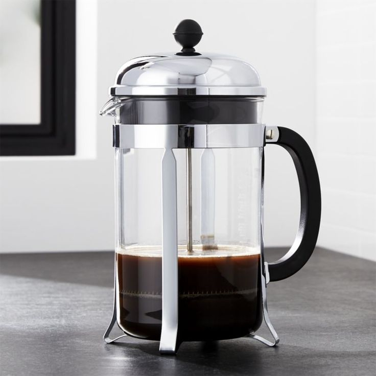An original, dome-topped Bodum French press coffee maker with contemporary…