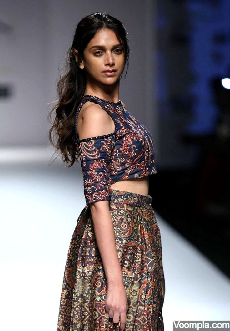 Aditi Rao Hydari models for designer Shruti Sancheti wearing an ethnic denim crop top and wrap skirt. Her boho-chic look is completed with a messy out of bed look hairstyle. via Voompla.com