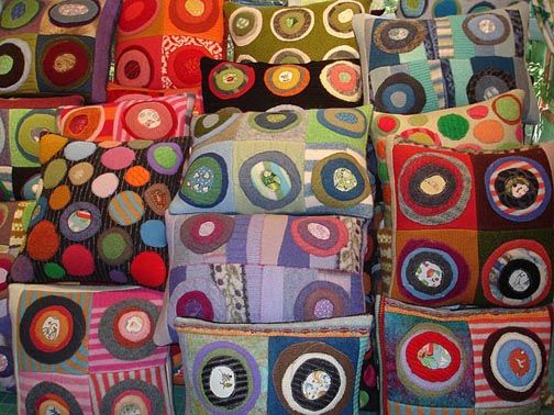 Cheerful pillows made from recycled sweaters by Martha Bishop, Williamston, Michigan.  Learn more at Lazygal.com.