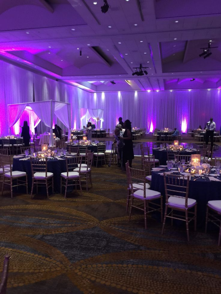 Wedding pipe and drape with purple uplighting and chiavari chairs at the BWI Hilton in Baltimore Maryland