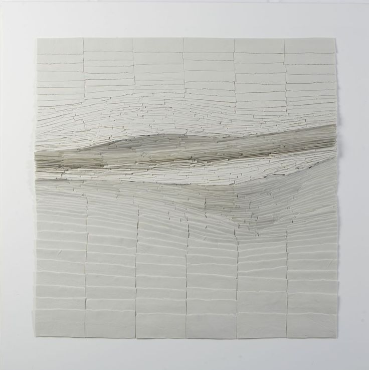"""""""Thin slates are grouped in rows, ordered from big to small, looking for some movement, ended up with a straight line in the middle to ensure a strong movement."""" WIT PORSELEIN / Never Still Always Changing  - Jeanne Opgenhaffen"""
