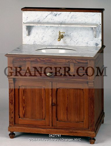 This is a Granger licensable image titled 'DECORATIVE ARTS.  Louis Philippe style pitch pine dressing table with grey flecked white marble top inset with oval washbasin, France, 19th century Full credit: De Agostini / J. M. Zuber / Granger, NYC -- All Rights Reserved.' by Granger, NYC All rights reserved. You may not copy, publish, or use this image except for sample layout ('comp') use only. You must purchase the image from Granger in order to use it for ANY other p...