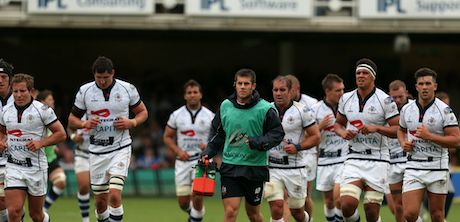 The Bristol team leave the field at half-time, alongside S Coach Andrew Petts