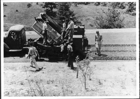 Civilian Conservation Corps members pave the Blue Ridge Parkway, 1936.