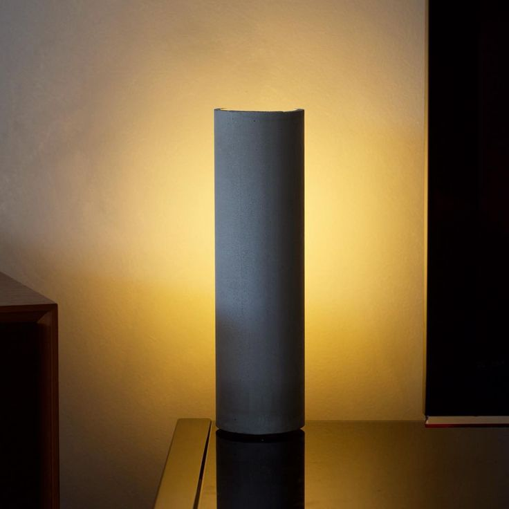 Introducing ••• Beam ••• mood lamp made from concrete • the tube reflect and diffuse the light • for a cozy atmosphere or indirect lighting  #design #concrete #glass #reflection #lamp #light #lighting #gold #black #silhouette #modern #handmade #handcrafted #westindies #caribbean #antilles #martinique #home #interior #deco #decor #decoration #lightisvibe #beam