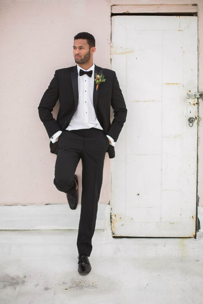 Online Tuxedo Rental for Men- classic black groomsman suit and bowtie style- boutonniere