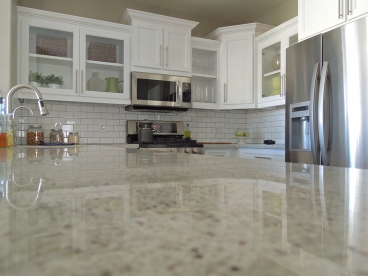 THIS IS IT!!! Kashmir white granite counters, tan walls, glass cabinets, subway tile backsplash, gray grout. LOVE IT!!!