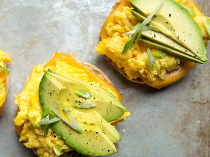 Scrambled Egg and Avocado Breakfast Sandwiches | This simple and satisfying breakfast sandwich recipe calls for using American cheese, but it's equally as delicious with Gruyere or sharp cheddar ch...