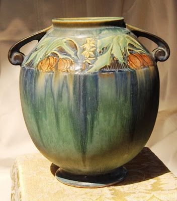 Baneda - Roseville pottery.  Took it out of our neighbor's trash!  Perfect. Very $$$ then the cats broke it!