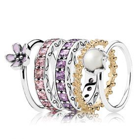 PANDORA sterling silver cherry blossom ring with pink enamel $65, sterling silver Eternity ring with pink cubic zirconia $179, sterling silver Eternity ring with purple cubic zirconia $179, 14 carat gold floral ring $445 and sterling silver ring with white freshwater cultured pearl $89