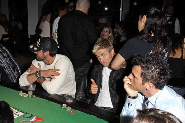 """Maksim Chmerkovskiy and Tony Dovolani - Derek Hough enjoys a neck massage during a charity poker tournament with his fellow """"DWTS"""" dancers"""