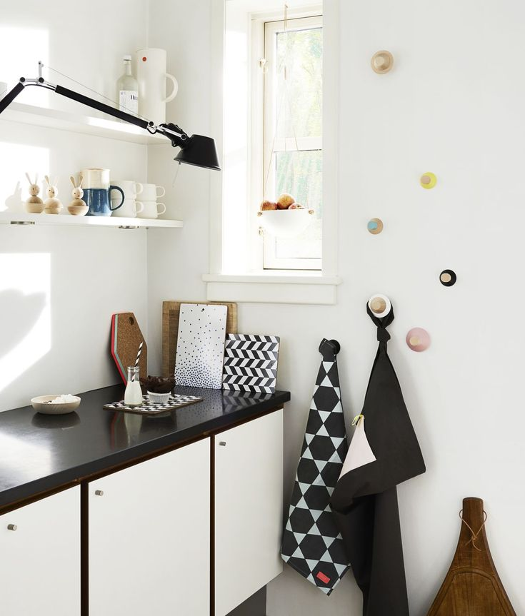 Cute kitchen - I could probably do a black counter top with black counters and keep the doors white. Might look pretty cool actually