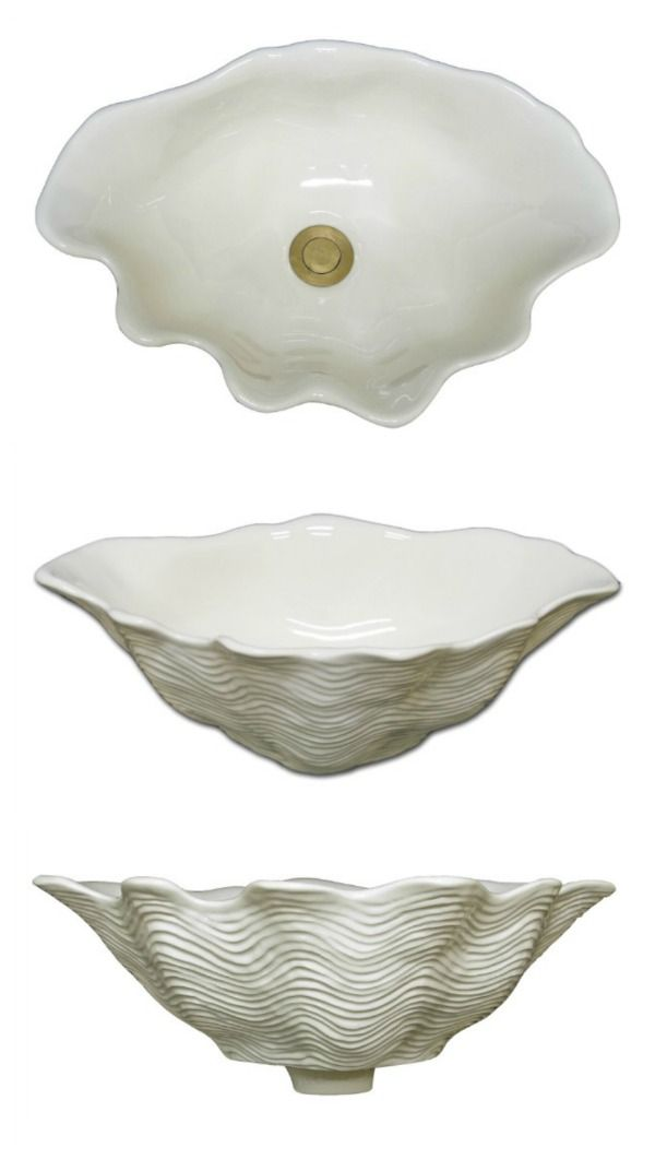 the marzi oval shell ceramic bath sink is a handcrafted ceramic bath vessel sink shaped like a sea shell for countertop