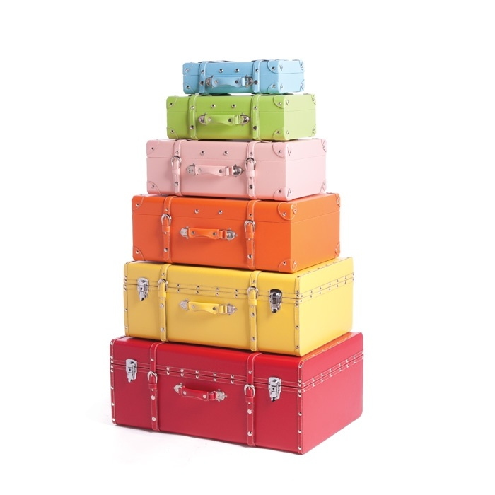These are so bright and cheery 0 you could also spray paint some of your own...Great color inspirations ~  Kaluga Storage Trunks Set of 6