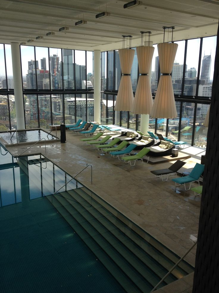 PHOTO 8: The absolutely stunning pool at  Crown Metropol boasts impressive views of the city.  Poolside tiles feature the hexagonal pattern seen throughout the complex.  The 3 lamps are larger than life and their inclusion is critical to the overall impact.