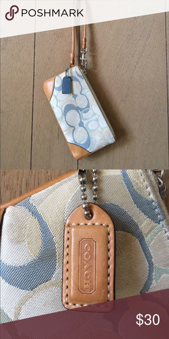 """Small blue/cream coach clutch Coach clutch with blue/aqua/cream """"c's"""" material has a satin like finish- and there are some small spots on it that mostly blend in with the cream background . Coach Bags Clutches & Wristlets"""