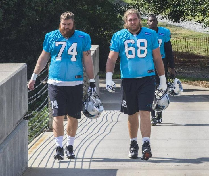 Carolina Panthers Mike Remmers (74) and Andrew Norwell (68) head to practice.he Carolina Panthers held practice 09.10.15 midday at their practice field near Bank of America Stadium.