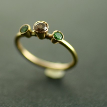 Green and Champagne Diamond Three Stone Ring. oh my...