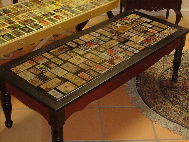This guy took a beat up coffee table and refurbished it into a tobacco card masterpiece.  Nice.