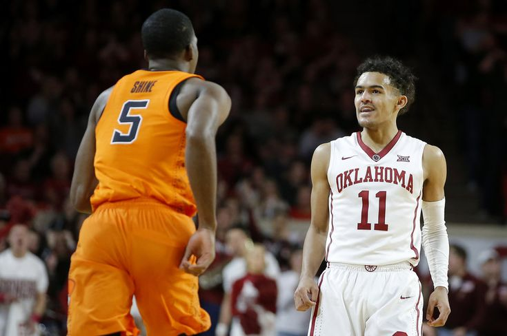 Oklahoma's Trae Young (11) looks toward Oklahoma State's Tavarius Shine (5) after making a basket during a Bedlam basketball game between the Oklahoma Sooners (OU) and the Oklahoma State Cowboys (OSU) at Lloyd Noble Center in Norman, Okla., Wednesday, Jan. 3, 2018. Photo by Bryan Terry, The Oklahoman