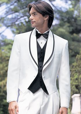 After Six Rainbow Shawl Tails White Tuxedo. This white tailcoat can be worn by itself or with the insert (as pictured) to add an additonal elegance to this full-dress look. Available inserts are: black lapel with white trim or white lapel with black trim. #newyearseve, #eventplanning, #tux, #whitetuxedo, #tuxedojunction, #lasvegastux, #weddingtuxedo, #tailcoat, #formal, #tuxedo