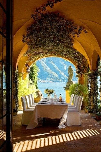luxury outdoor dining area with vaulted ceiling