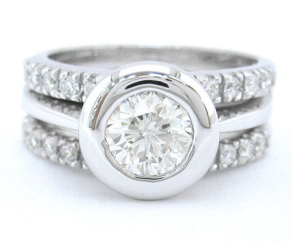 Round diamond engagement ring and bands bezel set by KNRINC, $2350.00 This is perfect. Classy, artsy, unique, and clean.