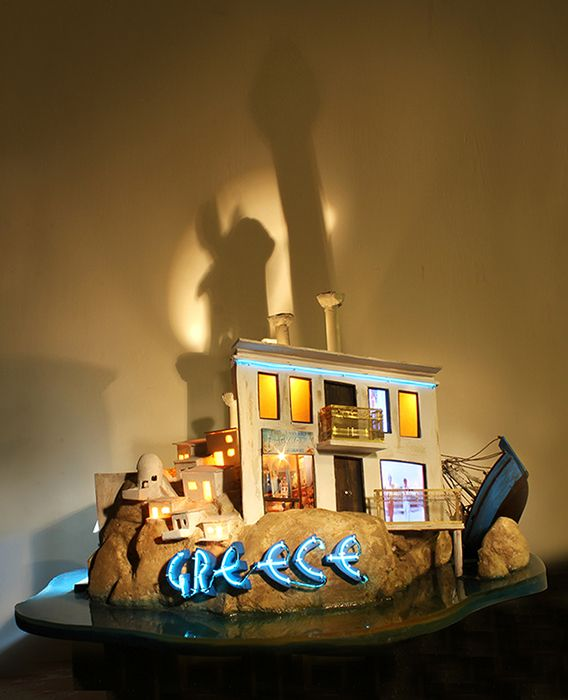 Greek Souvenir, 2013, Wood, paint, lights, electroluminescent wire, fake landscaping and water, lcd screen, media player, speakers, transformer, 37 x 58 x 50.8 cm, unique