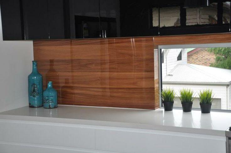 Timber floorboard splashback in kitchen