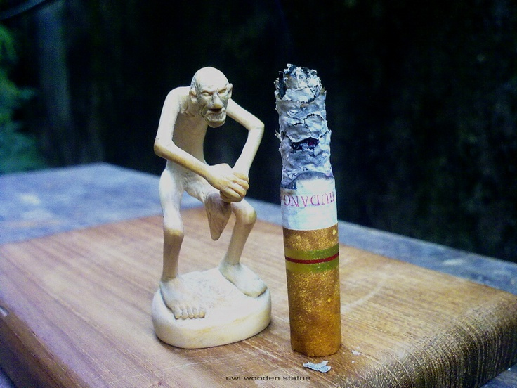 wooden sculpture  little man cigarette  uwi wiedh