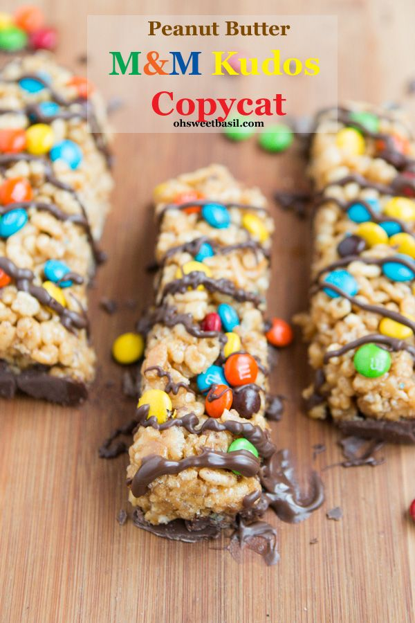 Peanut Butter M&M Kudos Copycat Bar  | A handy way to enjoy those indulgent candies that you always try to eat before you get home from your weekly shopping trip without the kids. Don't tell us that we are the only ones who do that? Try this awesome recipe, and don't forget to cut them into bite sized pieces and freeze a few. You're welcome. @ohsweetbasil