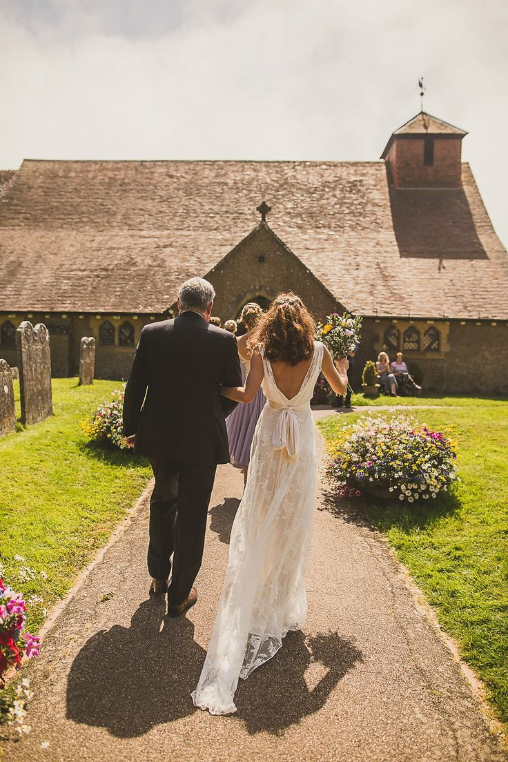 Ashleigh wore an elegant Charlie Brear gown for her sunshine and sunflower filled wedding. A Mariachi band entertained guests at the reception. Bridesmaids wore ASOS. Photography by The Springles.