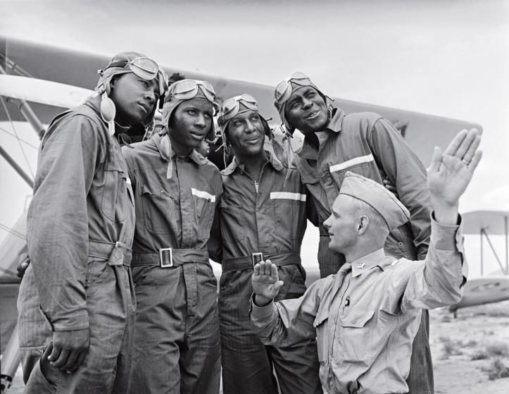 Members of the U.S. Army Air Corps' legendary 99th Pursuit Squadron, the Tuskegee Airmen, receive instruction about wind currents from a lieutenant in 1942. The Tuskegee fliers - the nation's first African American air squadron - served with distinction in the segregated American military. Gabriel Benzur—Time & Life Pictures/Getty Images