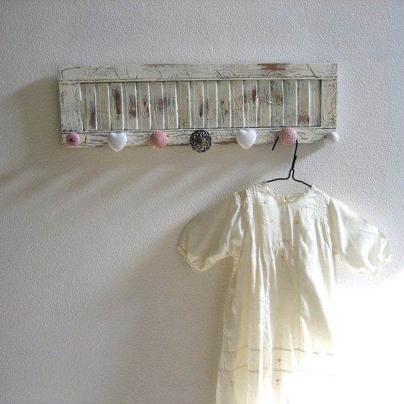 add mismatched knobs to a shutter... cute! Love love love this! Would be great for cassies room if girly or a couple neutral for the shoe room
